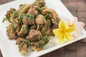Syeam piglet tossed in fresh laotian herbs